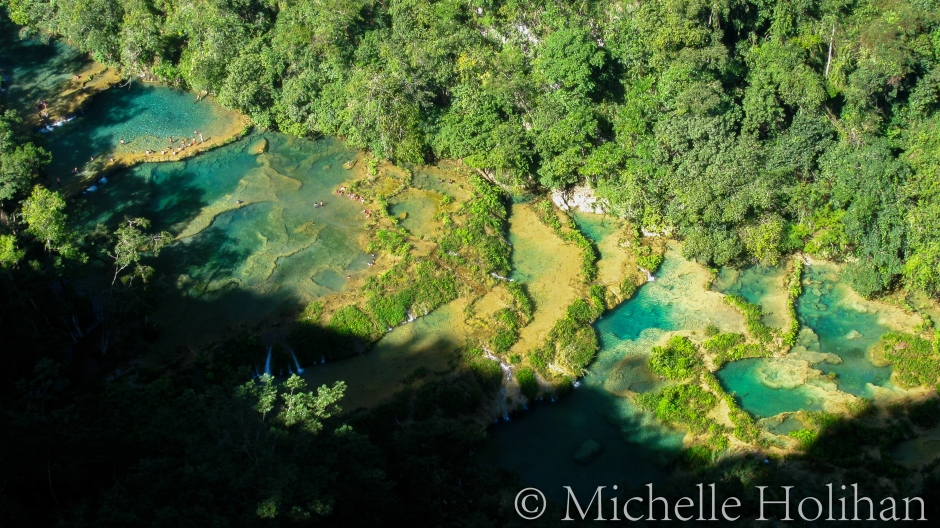 People swimming in the clear waters of Semuc Champey